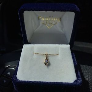 14k gold necklace with a small diamond